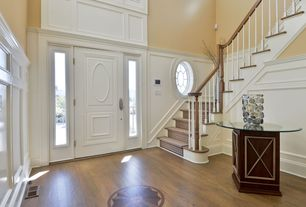 Traditional Entryway with High ceiling, Hardwood floors, specialty window, Paint, specialty door, Wainscotting