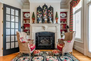 Traditional Living Room with French doors, Hardwood floors, Built-in bookshelf, Cement fireplace, Crown molding