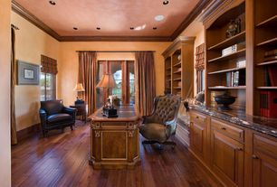 Traditional Home Office with can lights, Glass panel door, Window seat, Built-in bookshelf, Casement, Hardwood floors