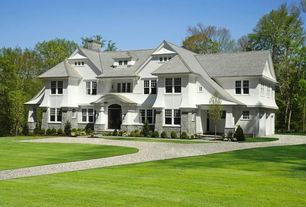 Traditional Exterior of Home with Pathway, Gravel driveway, Exterior stone siding, double-hung window, Paint 1