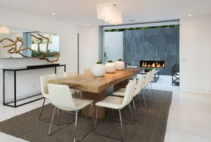 Modern Dining Room with Kazu large dragon tree root/iron sculpture, Concrete floors, Emmerson reclaimed wood dining table