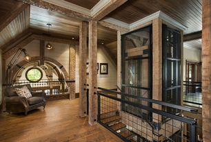 Craftsman Entryway with Hardwood floors, specialty window, Exposed beam, Standard height, Columns, can lights, Pendant light
