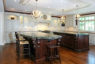 Traditional Kitchen with Raised panel, Chandelier, Kitchen island, Custom hood, Glass panel, Inset cabinets, Pendant light