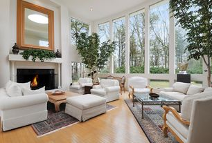 Contemporary Living Room with Cement fireplace, High ceiling, Hardwood floors