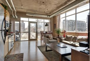 Modern Great Room with Hardwood floors, French doors, picture window, Pendant light, Casement, interior brick, High ceiling