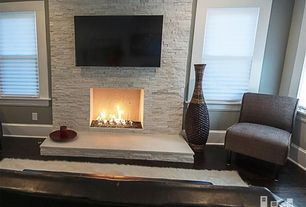 Contemporary Living Room with stone fireplace, Hardwood floors