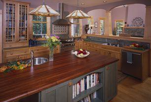 Craftsman Kitchen with Flat panel cabinets, Pendant light, Columns, Kitchen island, Subway Tile, Wood counters, Flush