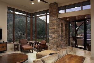 Contemporary Living Room with sandstone tile floors, Ceiling fan, specialty door, High ceiling