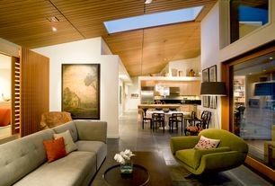 Contemporary Living Room with Concrete tile , Skylight, Pendant light