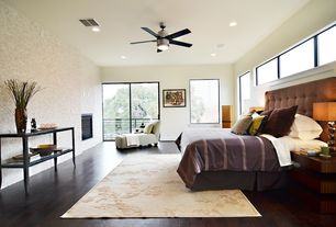 Contemporary Master Bedroom with Laminate floors, Nuloom handmade pino spring season floral rug, flush light, Ceiling fan