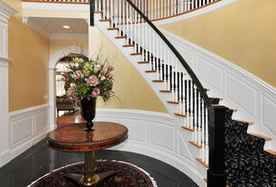 Traditional Staircase with Cathedral ceiling, Hardwood floors, Wainscotting