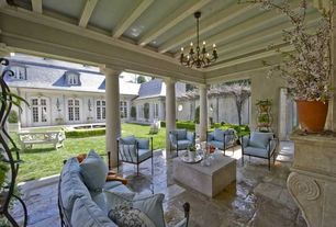 Traditional Patio with Fountain, Pond, Cast Classics San Pietro Patio Sofa, French doors, exterior stone floors, Pathway