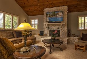 Rustic Living Room with picture window, Standard height, Carpet, stone fireplace, Crown molding, Fireplace