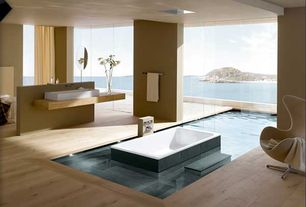 Modern Master Bathroom with Master bathroom, Frameless sliding door, Paint, Vessel sink, Standard height, Bathtub, Skylight