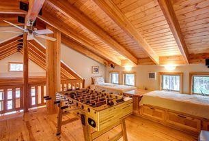 Craftsman Great Room with Columns, Built-in bookshelf, Ceiling fan, Window seat, Wall sconce, Hardwood floors, Exposed beam