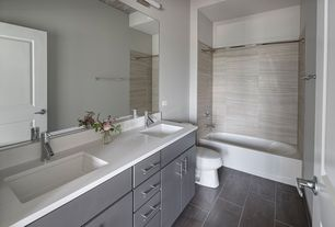 Modern Master Bathroom with slate tile floors, Master bathroom, specialty door, Corian counters, Double sink, Undermount sink