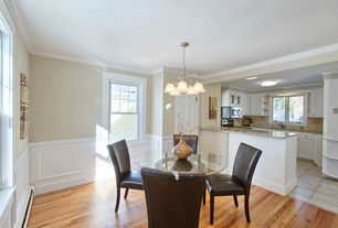 Traditional Dining Room with Wainscotting, Pendant light, Crown molding