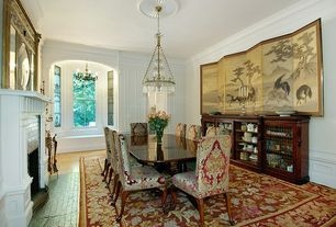 Traditional Dining Room with brick fireplace, Wainscotting, Fireplace, Hardwood floors, Cement fireplace, Window seat