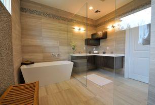 Contemporary Master Bathroom with Master bathroom, specialty tile floors, specialty door, Limestone tile counters, Flush