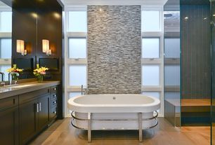 Contemporary Master Bathroom with Corian counters, stone tile floors, partial backsplash, Bathtub, frameless showerdoor
