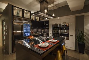 Contemporary Kitchen with Frigo Design Stainless Steel Countertops, High ceiling, specialty door, L-shaped, Concrete tile