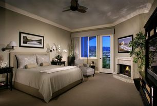 Traditional Master Bedroom with Fireplace, bedroom reading light, Carpet, Cement fireplace, Crown molding, French doors