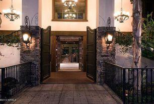Eclectic Entryway with picture window, Chandelier, Hardwood floors, Standard height, Wall sconce, specialty door