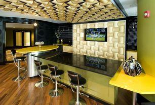 Eclectic Bar with Hardwood floors, Built-in bookshelf, Standard height, Pendant light