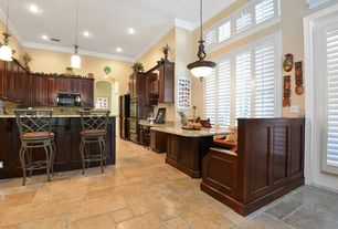 Traditional Kitchen with Crown molding, Window seat, Breakfast bar, U-shaped, Stone Tile, Inset cabinets, Breakfast nook
