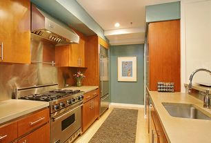 Modern Kitchen with Galley, Corian counters, Silestone-Quartz Countertop in Daria, Destiny: slab cabinets, Stainless Steel