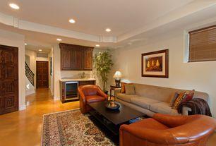 Mediterranean Basement with specialty door, Oriental rug, Concrete floors, Linon simon chair