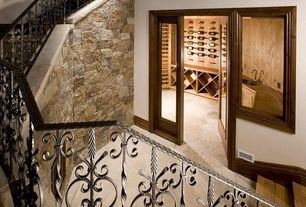 Mediterranean Wine Cellar with limestone floors, French doors