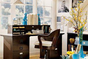 Traditional Home Office with Casement, Pendant light, Built-in bookshelf, Standard height, Hardwood floors