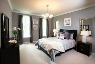 Traditional Master Bedroom with Bedside table, Fabric curtain, Ceiling molding, Chandelier, Ikea Nyvoll Bed Frame, Carpet