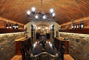 Traditional Wine Cellar with limestone floors, Wall sconce, interior brick, Chandelier