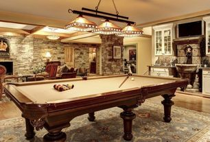 Traditional Game Room with Exposed beam, Pendant light, Hardwood floors, flush light, stone fireplace, specialty door