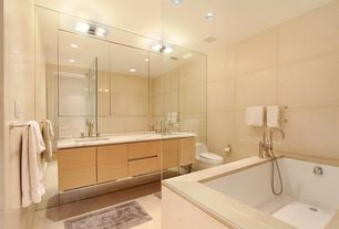 Contemporary Master Bathroom with Complex marble counters, wall-mounted above mirror bathroom light, Double sink, Flush