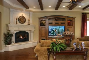 Mediterranean Living Room with Fireplace, Cement fireplace, Hardwood floors, Standard height, Exposed beam, picture window