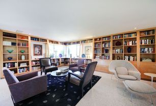 Contemporary Library with Omega chair and ottoman, simple granite floors, Flower side table, Built-in bookshelf