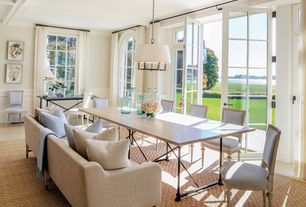 Contemporary Dining Room with Pendant light, Arched window, sandstone tile floors, French doors, Chair rail