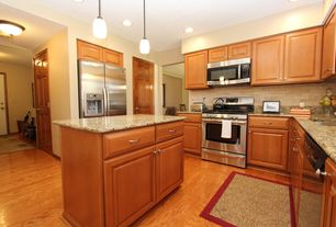 Modern Kitchen with Standard height, Kitchen island, Limestone Tile, dishwasher, Raised panel, U-shaped, six panel door