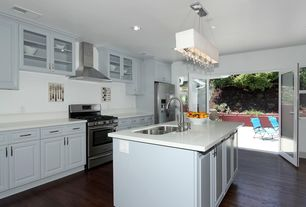 Traditional Kitchen with Multiple Sinks, Wall Hood, One-wall, Corian counters, Flush, Built In Refrigerator, gas range