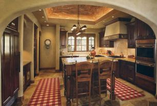 Country Kitchen with Complex granite counters, stone tile floors, Framed Partial Panel, electric cooktop, Paint, Custom hood