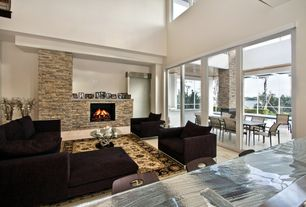 Contemporary Living Room with High ceiling, Carpet, travertine tile floors, stone fireplace