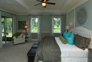 Traditional Master Bedroom with Ceiling fan, Crown molding, double-hung window, Chair rail, Carpet, Standard height