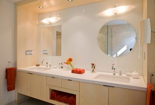 Contemporary Master Bathroom with Rain shower, Concrete floors, Flush, Double sink, flush light, Undermount sink, can lights