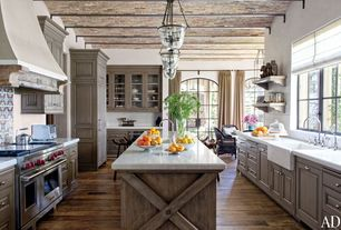 Country Kitchen with Simple marble counters, Breakfast nook, Farmhouse sink, Inset cabinets, Undermount sink, Glass panel