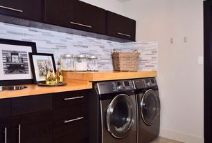 Contemporary Laundry Room with drop-in sink, laundry sink, Concrete floors, Standard height, Built-in bookshelf
