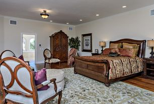 Mediterranean Master Bedroom with Hardwood floors, Crown molding, flush light
