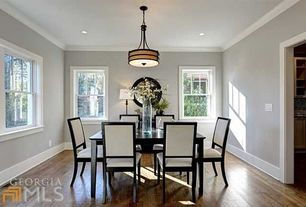 Traditional Dining Room with Hardwood floors, Crown molding, Pendant light